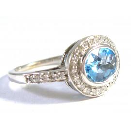14 kt zlatý prsten s brilianty 0.64 kt a 4 kt topazem